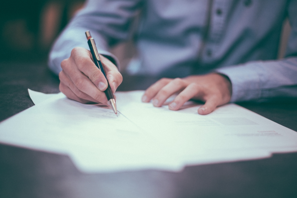 Person signing insurance deal